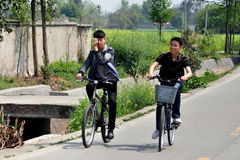 Pengzhou, China: Chinese Teenagers Riding Bicycles Stock Photography