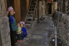 Two Chinese women and child, in courtyard of their house. Royalty Free Stock Image