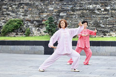 Two Chinese women practicing Tai Chi in a park, Xiang Yang, China Stock Photography