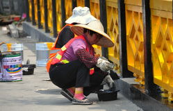 Jiu Chi Town, China: Women Painting Bridge Railing Stock Images