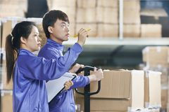 Two chinese workers in warehouse Royalty Free Stock Image