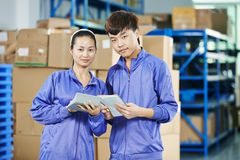 Two chinese workers in warehouse Royalty Free Stock Photo