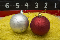 Two Chirstmas 's ball close up on yellow thread Royalty Free Stock Photo