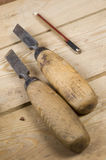Two chisels, a pencil. Chisels to work on wood, is a sharp woodcutting tools, designed for wood carving, making wooden objects and figures, a master carpenter Stock Image