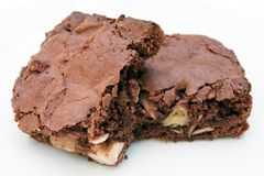 Two chocolate brownies stacked together on white Stock Images