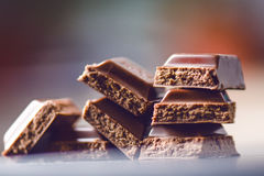 Two chocolate buildings on a dark background. energy and sugar. Broken bar. Chocolate blocks stack Royalty Free Stock Image
