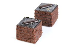 Two chocolate cakes against white background Royalty Free Stock Photography