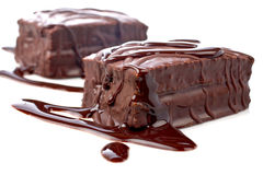 Two chocolate cakes with syrup Royalty Free Stock Photography