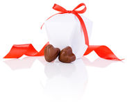 Two chocolate candies in heart shape, white box Stock Image