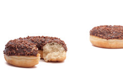 Two chocolate donut is broken half. Cut donut peach stock images