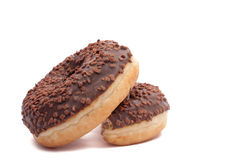 Two Chocolate Donuts with Sprinkles. Isolated on a White Background.  royalty free stock photos