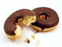 Two chocolate doughnuts Stock Photos