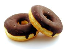 Two chocolate doughnuts royalty free stock photography