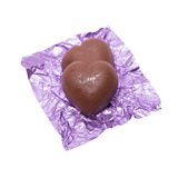 Two chocolate heart candy in puple foil on white background.  Royalty Free Stock Image