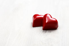 Two chocolate hearts Stock Images