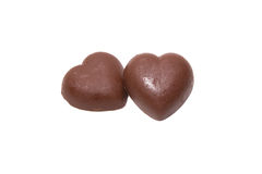 Two chocolate hearts on white background Stock Images