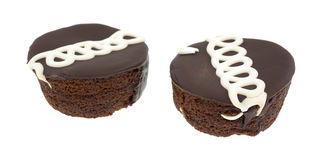 Two chocolate iced cakes Royalty Free Stock Image