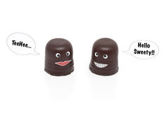 Two chocolate marshmallows having a conversation Royalty Free Stock Image