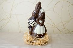 Two chocolate rabbits. Two tasty, embracing, chocolate hares, a loving couple royalty free stock photography