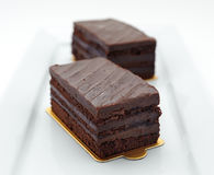 Two Chocolate sponge cakes Stock Images