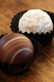Two chocolate truffles royalty free stock image