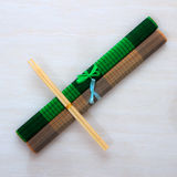Two chopsticks on bamboo mats. Two chopsticks on two bamboo mats Stock Photos