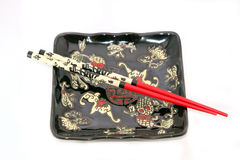 Two chopsticks over a bowl Royalty Free Stock Image