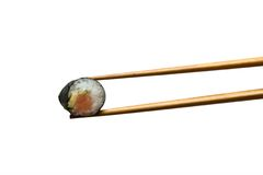 Two chopsticks with salmon roll Royalty Free Stock Photos