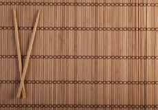 Two chopsticks on sushi background Royalty Free Stock Photos
