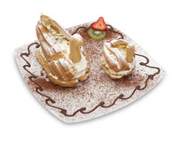 Two Choux Swans filled with Chantilly Cream Royalty Free Stock Image