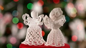 Two christmas angels decoration slowly spinning stock video