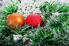 Two Christmas ball in green garland with bells Stock Image