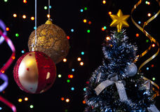 Two Christmas  ball, serpentine, tree  on a black Stock Photo
