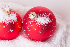 Two Christmas ball in the snow Royalty Free Stock Image