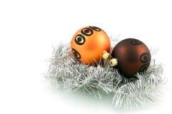 Two christmas balls. On pendulum isolated on white background stock image