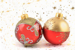 TWO CHRISTMAS BALLS. Two red and gold  christmas ornaments on stars background Stock Images