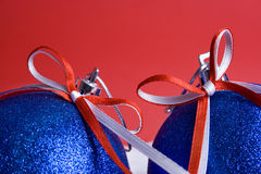 Two christmas balls. Red background Royalty Free Stock Image