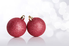 Two Christmas balls on abstract background Royalty Free Stock Photography