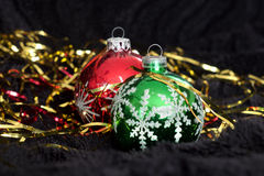 Two Christmas balls on black velvet Stock Photography
