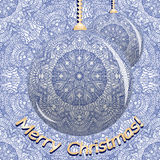 Two Christmas balls on a blue pattern in Indian style. Christmas or New Year background. Stock Photography