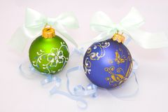 Two christmas balls with blue ribbon Royalty Free Stock Images