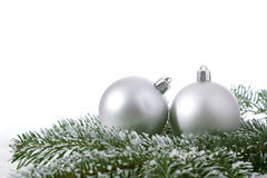 Two christmas balls branch fir Royalty Free Stock Photos