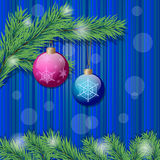 Two christmas balls and christmas tree branch Stock Images