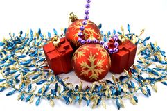 Two Christmas balls. With two gifts and a garland Stock Photos
