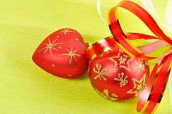 Two Christmas balls on a green background Stock Photography