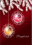 Two christmas balls hanging on a branch of fir. On dark red background Stock Photos