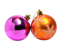 Two Christmas balls of orange and green Royalty Free Stock Photo