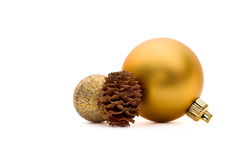 Two christmas balls and a pine cone Royalty Free Stock Image