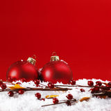 Two christmas balls on the snow Royalty Free Stock Photo