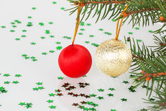 Two Christmas balls on the tree Stock Photo